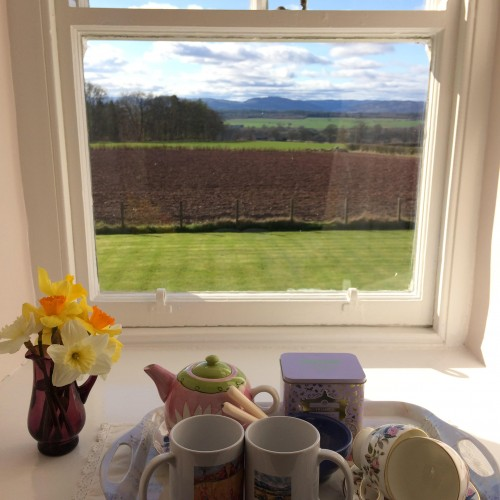 Tea and coffee tray on the window sill of the twin bedroom with a view across the garden to the Perthshire farm land