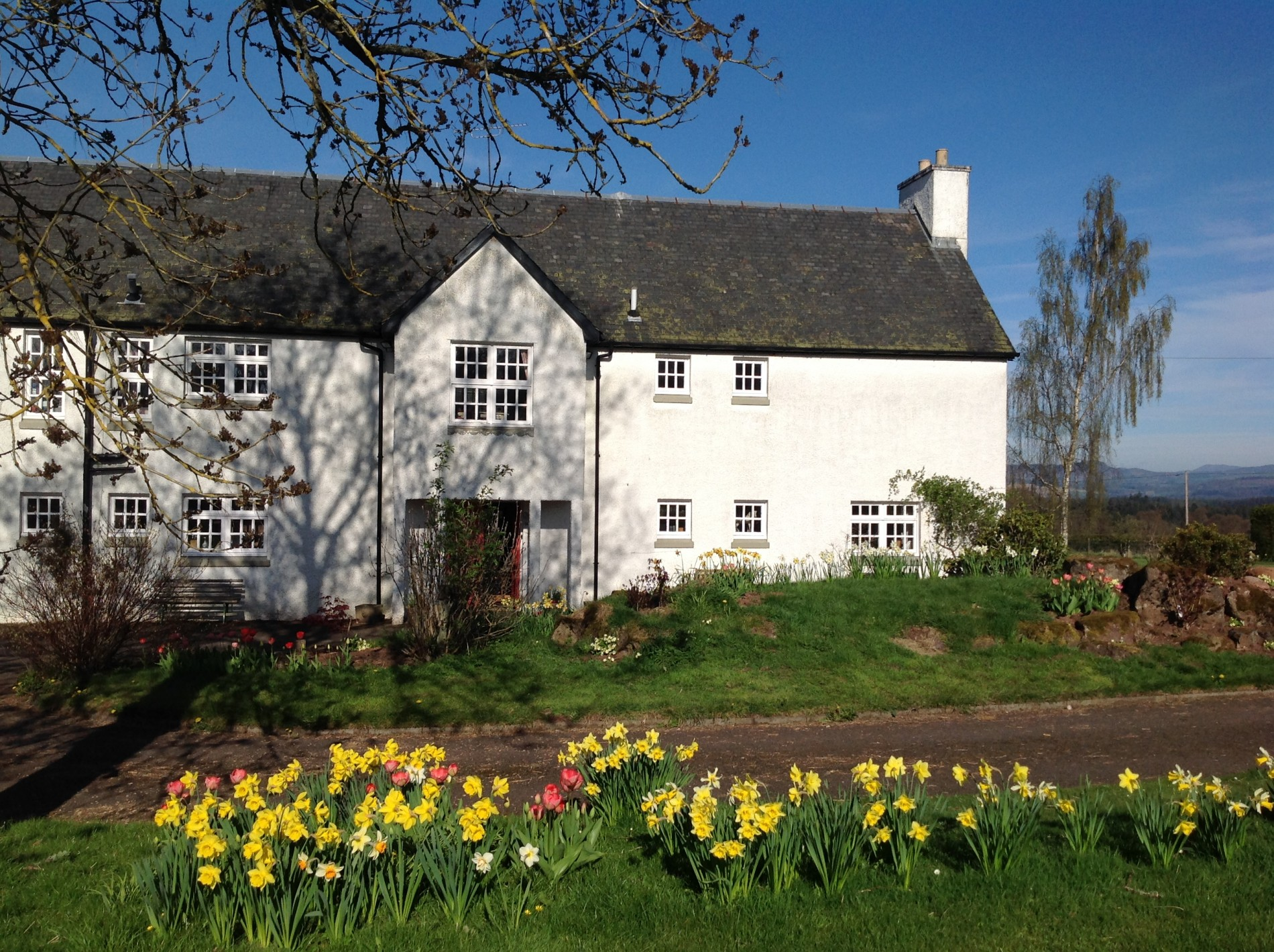 Park House bed and breakfast enjoying the spring sunshine as it warms the Perthshire mountains